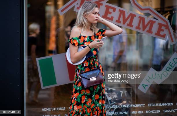 A model wearing off shoulder dress is seen outside Blanche during the Copenhagen Fashion Week Spring/Summer 2019 on August 7 2018 in Copenhagen...