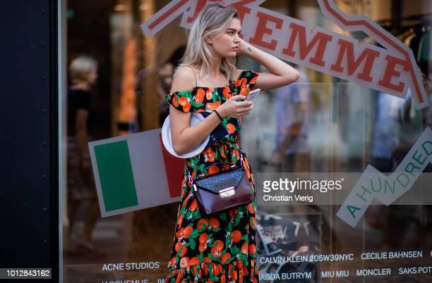 A model wearing off shoulder dress is seen outside Blanche during the Copenhagen Fashion Week Spring/Summer 2019 on August 7 2018 in Copenhagen...