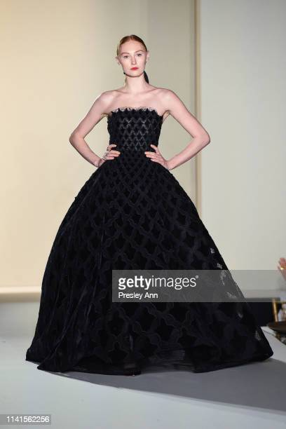 A model wearing Oscar de la Renta walks at the 31st Annual Colleagues Luncheon at the Beverly Wilshire Four Seasons Hotel on April 09 2019 in Beverly...