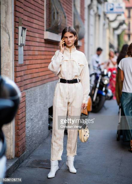 A model wearing overall is seen outside No 21 during Milan Fashion Week Spring/Summer 2019 on September 19 2018 in Milan Italy