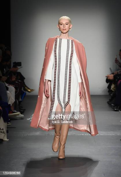A model wearing Patricia Govea Collection with shoes by Per Fidem bags by SSY designs and accessories by Norton and Hodges walks the runway during...