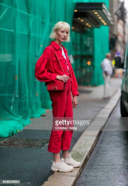 A model wearing red denim jacket red cropped pants outside Bik Bok Runway Award on August 24 2017 in Oslo Norway