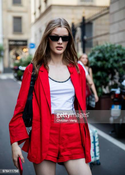 A model wearing red jeans shorts and jacket is seen outside Versace during Milan Men's Fashion Week Spring/Summer 2019 on June 16 2018 in Milan Italy