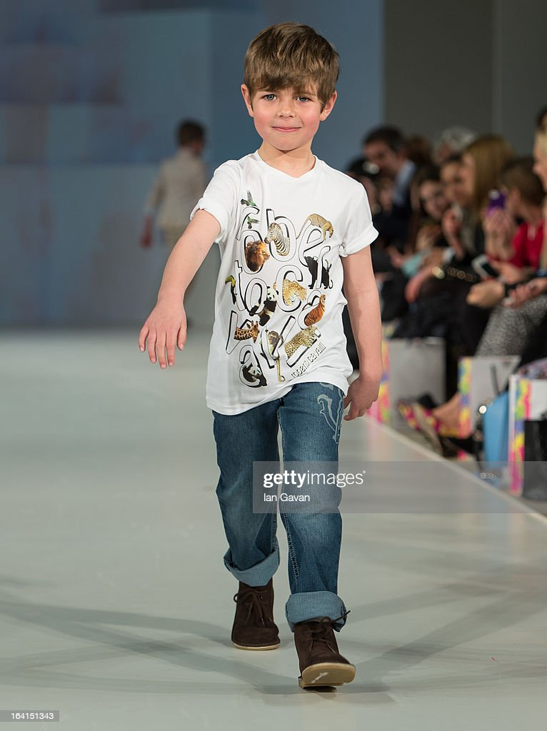 A model wearing Roberto Cavalli Spring/Summer '13 walks the runway at the Global Kids Fashion Week SS13 public show in aid of Kids Company at The Freemason's Hall on March 20, 2013 in London, England.