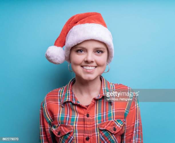 Model wearing Santa Hat and plaid shirt