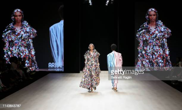 A model wearing Selam Fessahaye walks the runway during Arise Fashion Week on April 19 2019 in Lagos Nigeria