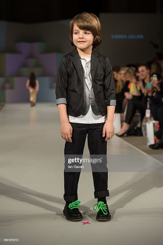 A model wearing Sierra Julian Spring/Summer '13 walks the runway at the Global Kids Fashion Week SS13 public show in aid of Kids Company at The Freemason's Hall on March 20, 2013 in London, England.