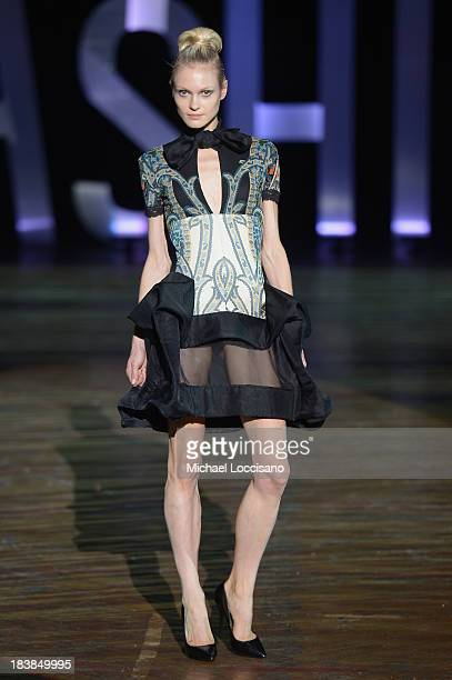 A model wearing Sukeina walks the runway during the 3rd Annual United Colors Of Fashion Gala at Lexington Avenue Armory on October 9 2013 in New York...