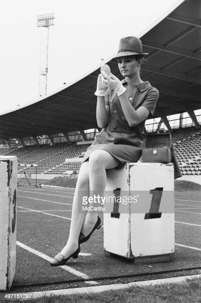A model wearing the uniform designed by Hardy Amies to be worn by female British athletes in the parade at the 1968 Olympic Games in Mexico City 11th...