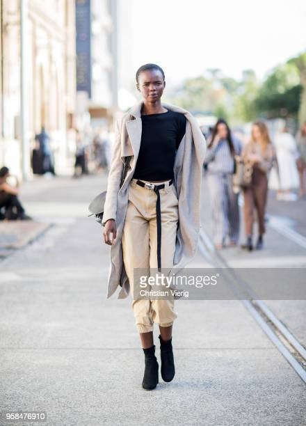 A model wearing trench coat beige cropped cargo pants during MercedesBenz Fashion Week Resort 19 Collections at Carriageworks on May 14 2018 in...