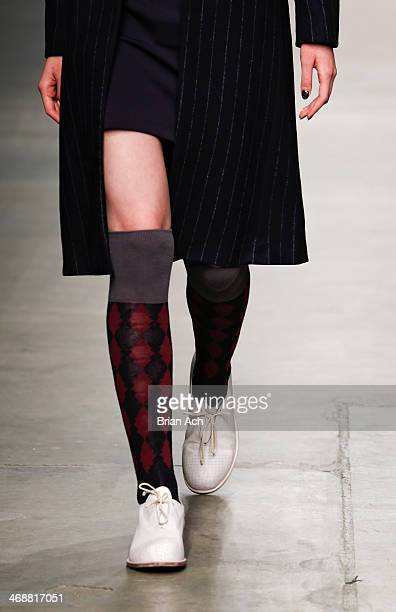 A model wearing wearing Tightology walks the runway at the Fashion Palette Australia Fall 2014 fashion show at Pier 59 on February 11 2014 in New...