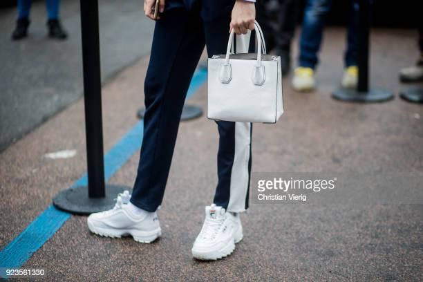 A model wearing white Fila sneakers bag seen outside Blumarine during Milan Fashion Week Fall/Winter 2018/19 on February 23 2018 in Milan Italy