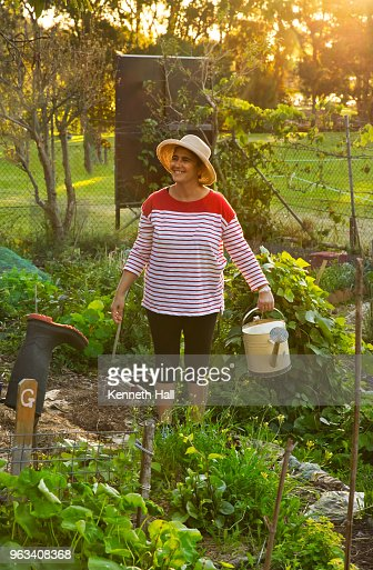 Model Wearing Wide Brimmed Hat Carrying Gardening Tools Stock Photo ...