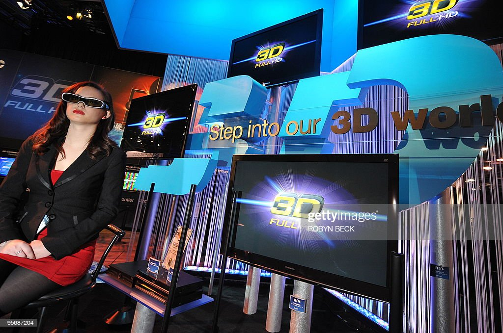 A model wears 3D glasses at a 3D display at the Panasonic booth at the 2010 International Consumer Electronics Show, January 8, 2010 in Las Vegas, Nevada. CES, the world's largest annual consumer technology tradeshow, runs from January 7-10. AFP PHOTO / Robyn Beck