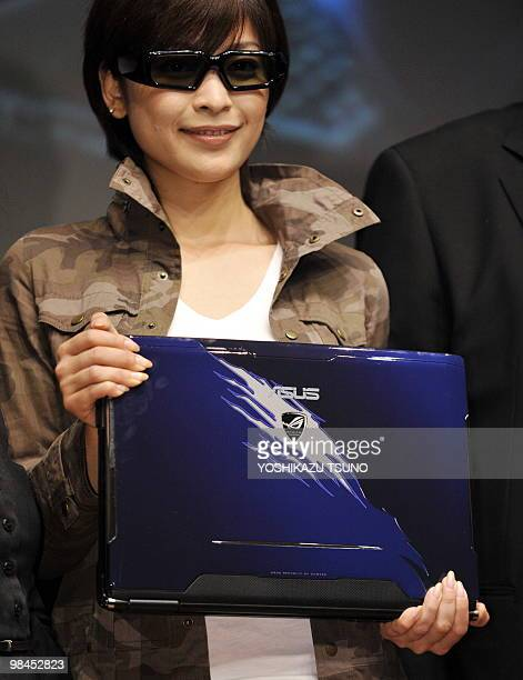A model wears 3d glasses displays a note book computer able to display 3D images by Asus at a press conference in Tokyo on April 14 2010 The new 3D...