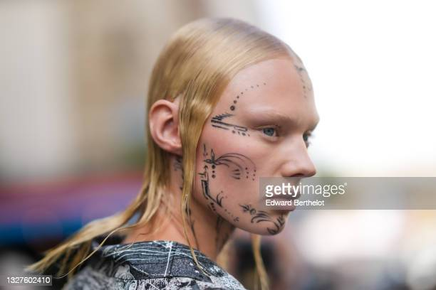 Model wears a black and white print pattern oversized shirt, a black shoulder bag, outside Jean-Paul Gaultier, during Paris Fashion Week - Haute...