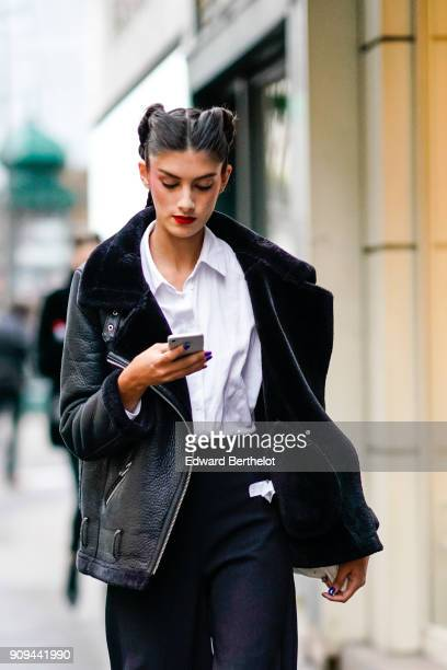 A model wears a black aviator jacket outside Alexis Mabille during Paris Fashion Week Haute Couture Spring/Summer 2018 on January 23 2018 in Paris...