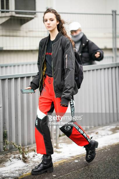 A model wears a black bomber jacket colored pants I AM GIA during Paris Fashion Week Womenswear Fall/Winter 2018/2019 on March 1 2018 in Paris France