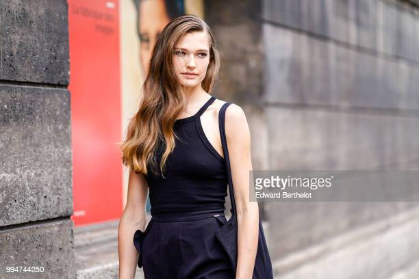 Model wears a black tank top, a black skirt , outside Elie Saab, during Paris Fashion Week Haute Couture Fall Winter 2018/2019, on July 4, 2018 in...