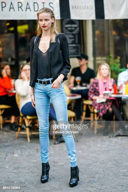 A model wears a blazer jacket blue jeans outside Koche during Paris Fashion Week Womenswear Spring/Summer 2018 on September 26 2017 in Paris France