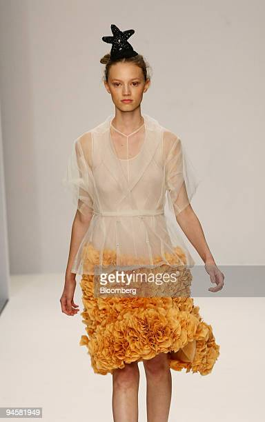 A model wears a blouse and skirt as she walks down the catwalk during the John Rocha fashion show in London UK on Monday Sept 17 2007 British...