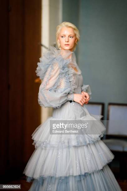 A model wears a blue mesh lace ruffled dress during the Ulyana Sergeenko Haute Couture Fall Winter 2018/2019 show as part of Paris Fashion Week on...