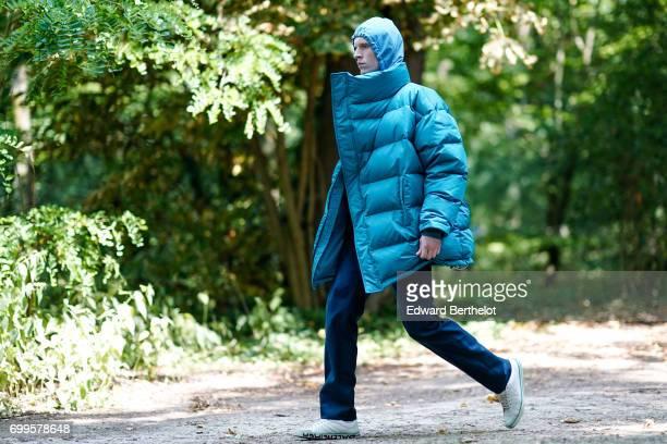 A model wears a blue puffer coat during the Balenciaga show during Paris Fashion Week Menswear Spring/Summer 2018 on June 21 2017 in Paris France