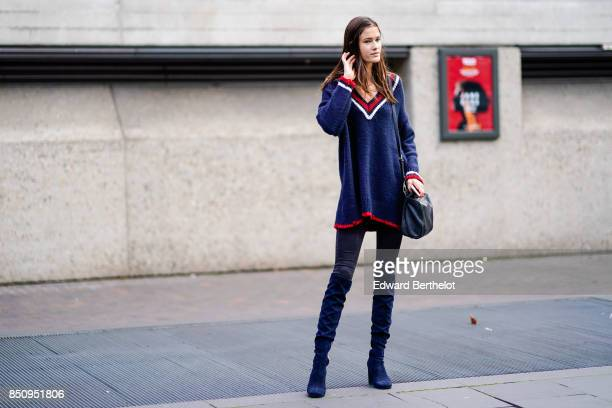 A model wears a blue white and red v neck top black pants blue shoes outside Roland Mouret during London Fashion Week September 2017 on September 17...