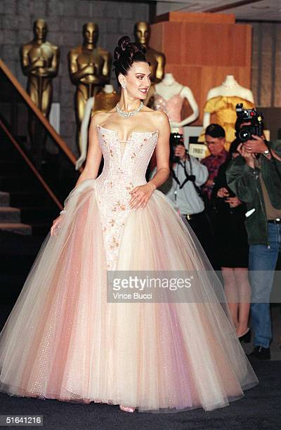 A model wears a Bob Mackie blush tulle gown with beaded bodice pink mesh anklestrap pumps and a 250 carat diamond necklace during an Academy Awards...