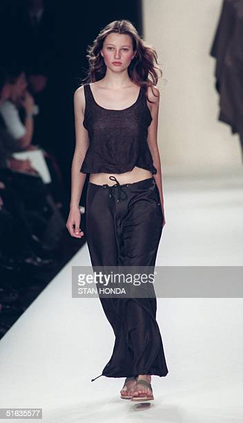 A model wears a brown tank top over brown drawstring pants during the Ralph Lauren fashion show 04 November in New York The show is part of the...
