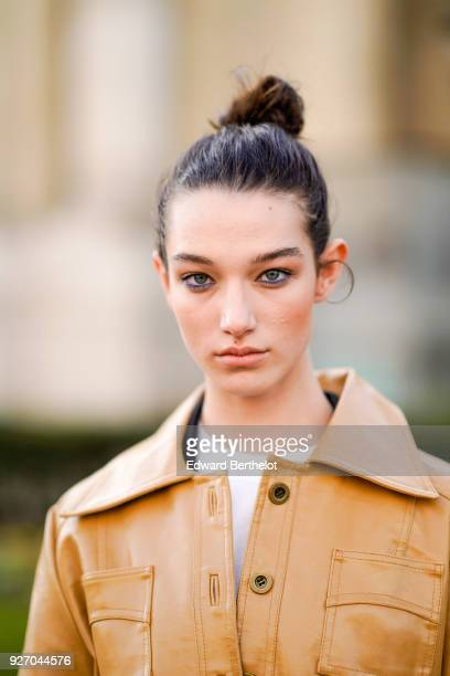 A model wears a brown trench coat during Paris Fashion Week Womenswear Fall/Winter 2018/2019 on March 3 2018 in Paris France