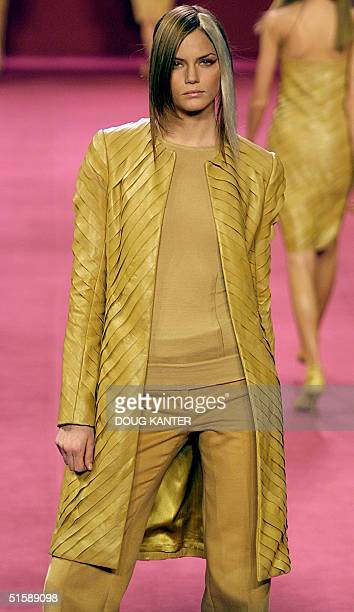 A model wears a camel leather paneled coat camel cashmere crewneck and camel cotton moleskin pant at the BCBG Max Azria women's show during Fall 2001...