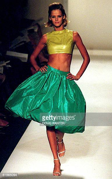 A model wears a chartreuse leather shell and turquoise silk taffeta pouf skirt at the Oscar de la Renta show during Spring 2001 Fashion Week in New...