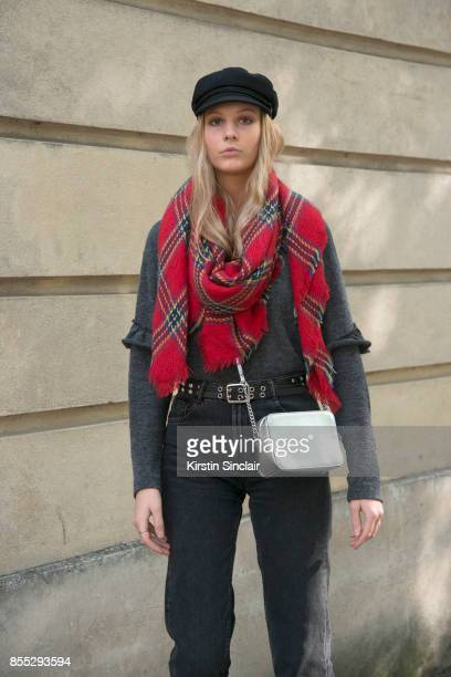 A model wears a chequered scarf day 1 of Paris Womens Fashion Week Spring/Summer 2018 on September 26 2017 in Paris France