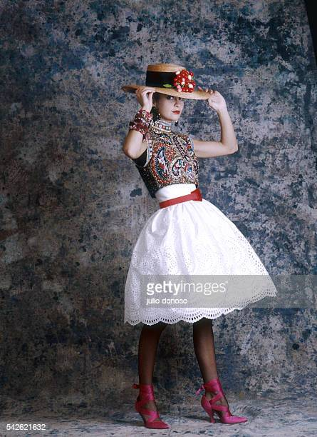 A model wears a Christian Lacroix dress from his 1987 springsummer haute couture line for Patou The white dress has a paisley bodice and is worn with...