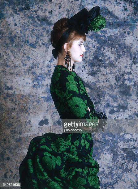 A model wears a Christian Lacroix dress from his 1987 springsummer haute couture line for Patou The 19th centurystyle dress is emerald green and...
