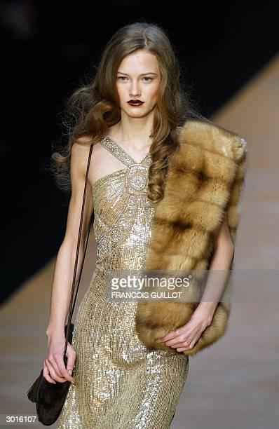 "Model wears a creation as part of Italian designer Anna Molinari for ""Blumarine"" Autumn/Winter 2004-2005 women's collection at Milan's fashion week..."