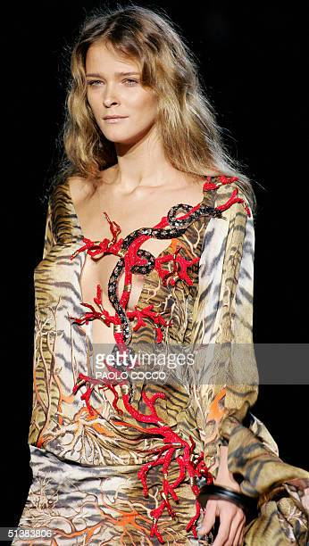 Model wears a creation as part of Roberto Cavalli's Spring-Summer 2005 women's collection at the Milan fashion week 02 October 2004. AFP PHOTO/Paolo...