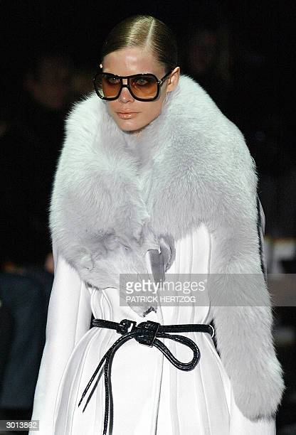 Model wears a creation as part of US designer Tom Ford's last show for Gucci during the Autumn/Winter 2004-2005 collections presentation at Milan...