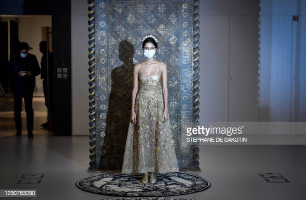 Model wears a creation by Christian Dior's during a fitting session at Christian Dior's Haute Couture fashion house in Paris on January 20, 2021. -...