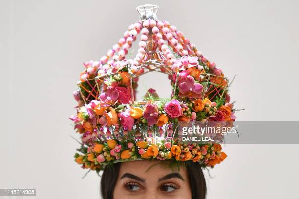 A model wears a creation by Dean Sharpe's Floral Studio at the 2019 RHS Chelsea Flower Show in London on May 20 2019 The Chelsea flower show is held...