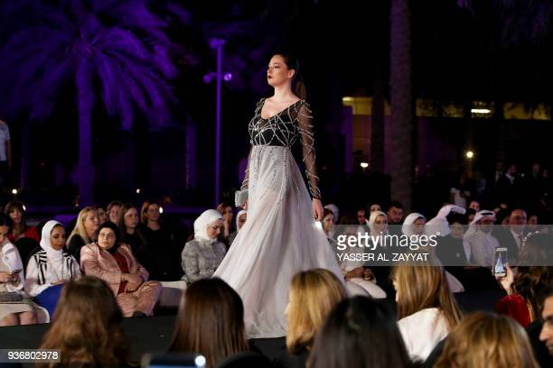 Model wears a creation by French designer Christophe Guillarme during the Kuwait International Fashion Week, in Kuwait City on March 22, 2018. / AFP...