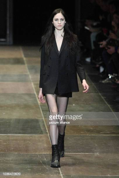 A model wears a creation by French designer Hedi Slimane as part of Saint Laurent fall/winter 2013/2014 collection presented during Paris pretaporter...