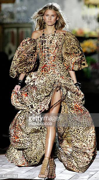 Model wears a creation by Italian designer Roberto Cavalli during Milan Fashion Week's Spring/Summer 2005 women collections presentations 02 october...