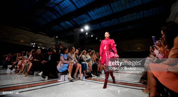 TOPSHOT A model wears a creation by Marina Hoermanseder during the Berlin Fashion Week in Berlin on January 19 2017 / AFP PHOTO / Tobias SCHWARZ