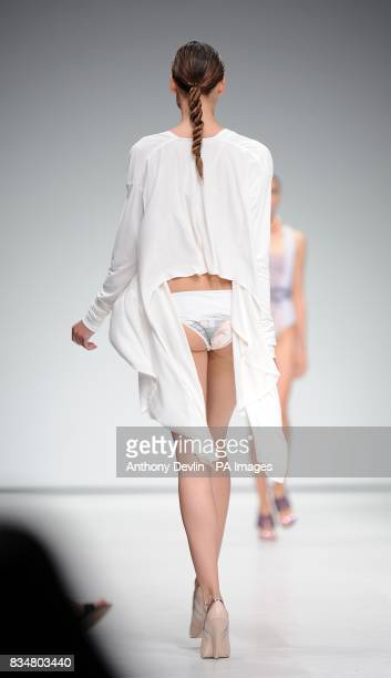 A model wears a creation by Marios Schwab during London Fashion Week at the Topshop Venue P3 University of Westminster 35 Marylebone Road NW1 5LS