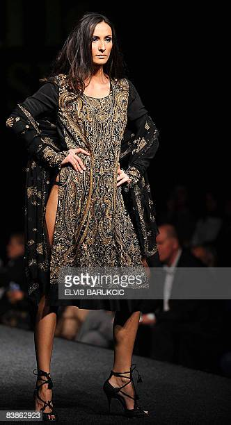 A model wears a creation by Pakistani designer Saim Ali during a show as part of the autumnwinter edition of the Sarajevo Fashion Week late on 30...
