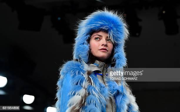 A model wears a creation by Sportalm at the Berlin Fashion Week in Berlin on January 18 2017 / AFP / Tobias SCHWARZ