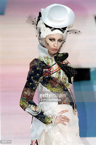 A model wears a creation by the fashion designer Christian Lacroix as she walks down the runway January 22 2002 at the Spring/Summer 2002 Fashion...