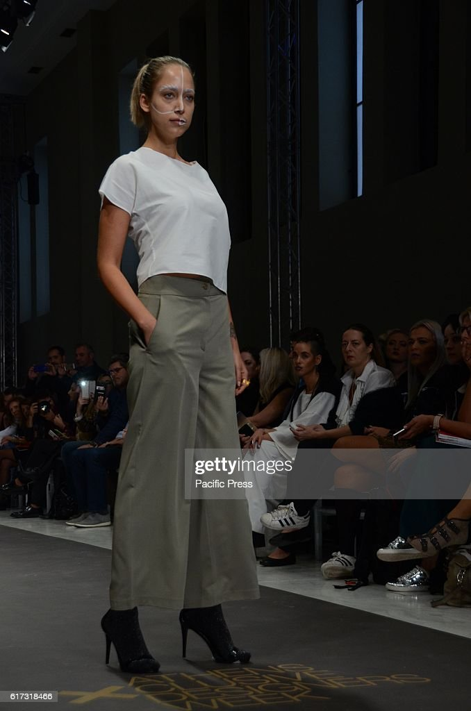 A model wears a creation of Dimitrios Ordoulidis fashion designer. Second day of the 10th Athens Xclusive Designers Week fashion event in Athens with many Greek fashion designers showcasing their creations.